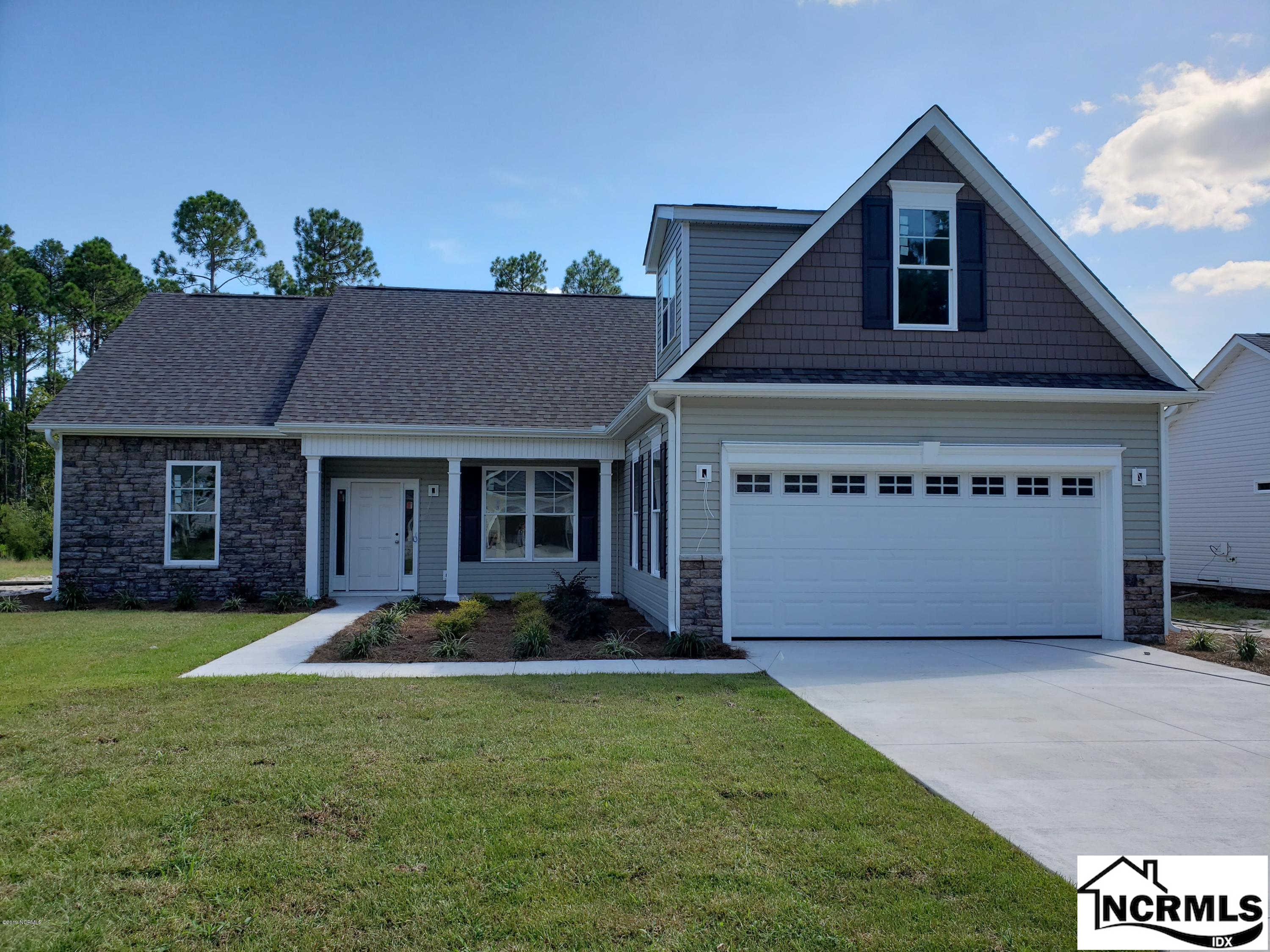 15 Edinburgh Drive NW, Shallotte, NC 28470 now has a new price of $246,425!