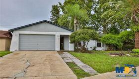 8711 Woodcrest Drive, Port Richey, FL 34668