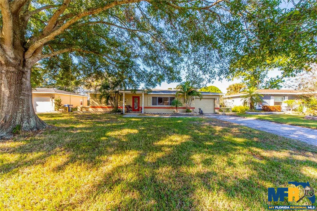 5132 Lake Charles Drive N, Kenneth City, FL 33709 now has a new price of $249,000!