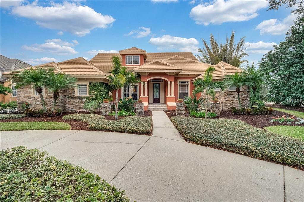 7425 Park Springs Circle, Orlando, FL 32835 now has a new price of $669,900!