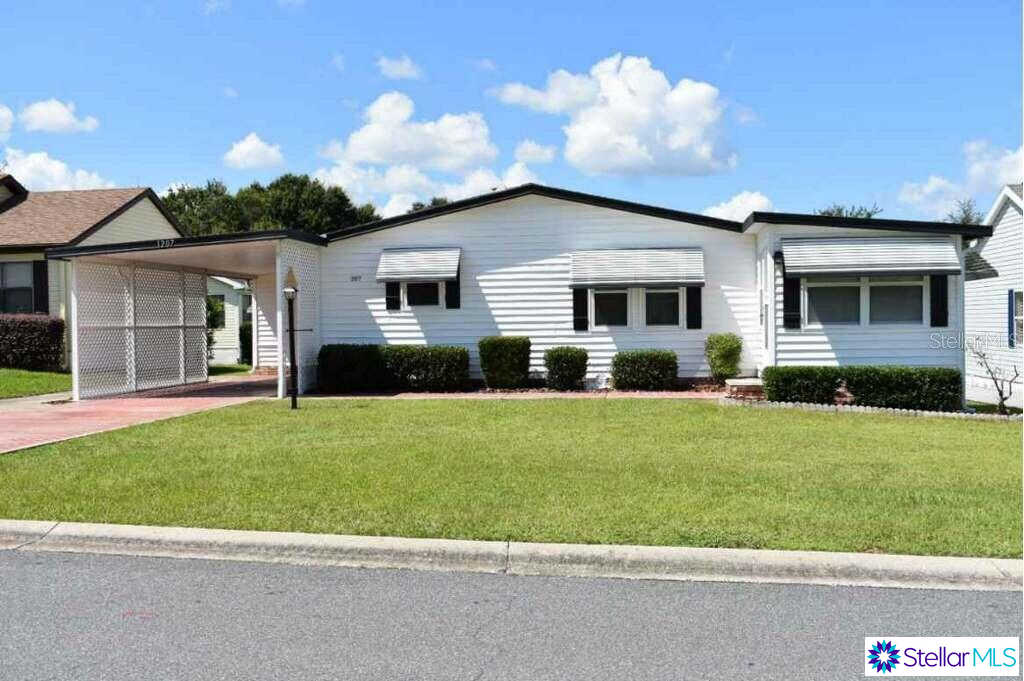 1207 Granada Court, Lady Lake, FL 32159 is now new to the market!