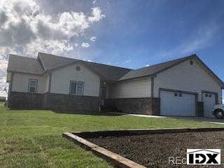 763 Arrowhead Street, Strasburg, CO 80136 now has a new price of $539,900!