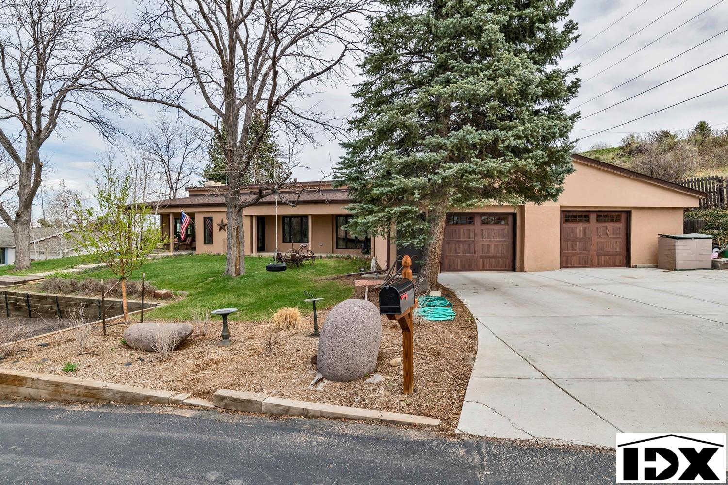 1520 Whippoorwill Drive, Lakewood, CO 80215 now has a new price of $750,000!