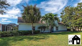 107 Palm Frond CT, Naples, FL 34104