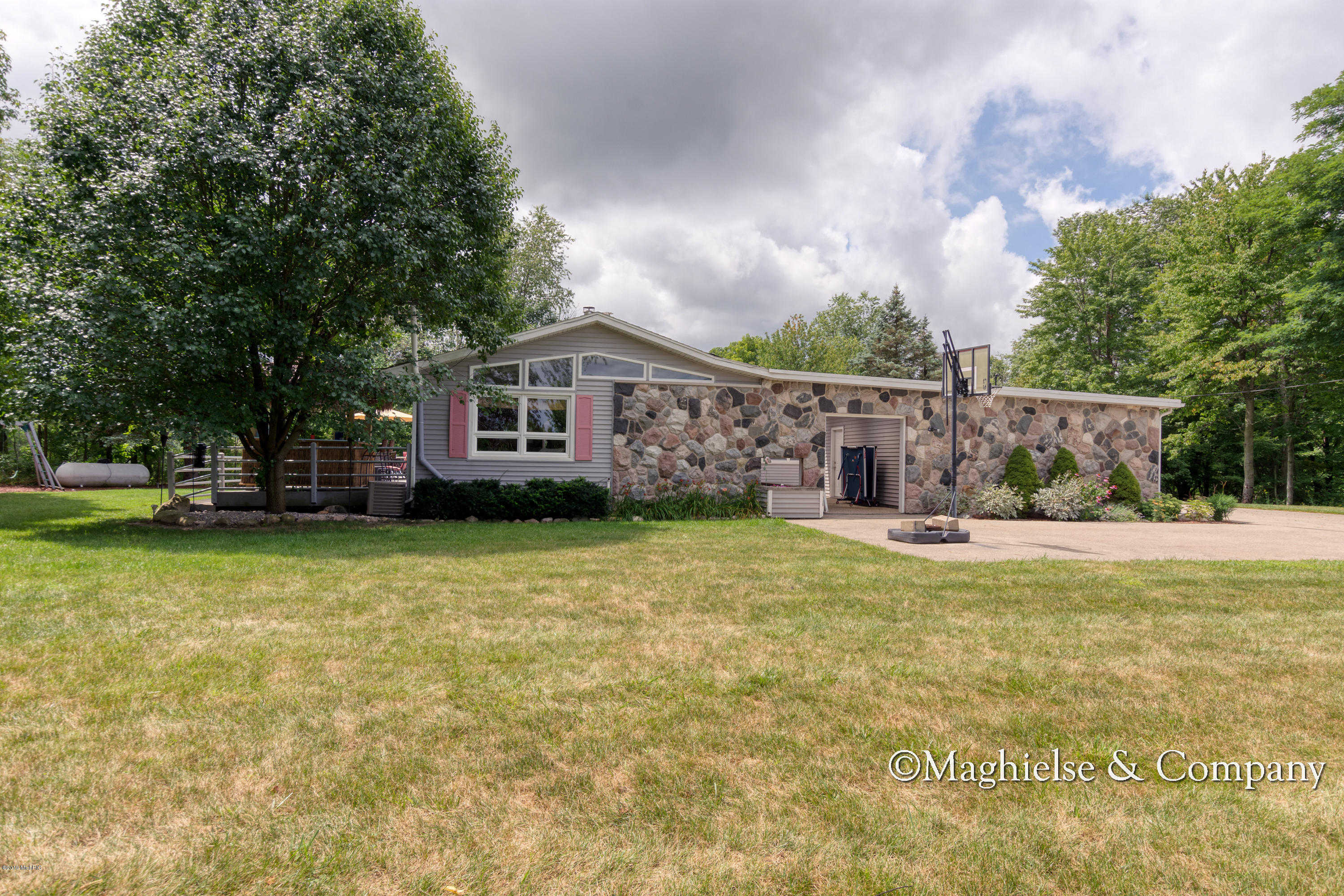 8280 Cannonsburg Rd NE, Ada, MI 49301 now has a new price of $410,000!