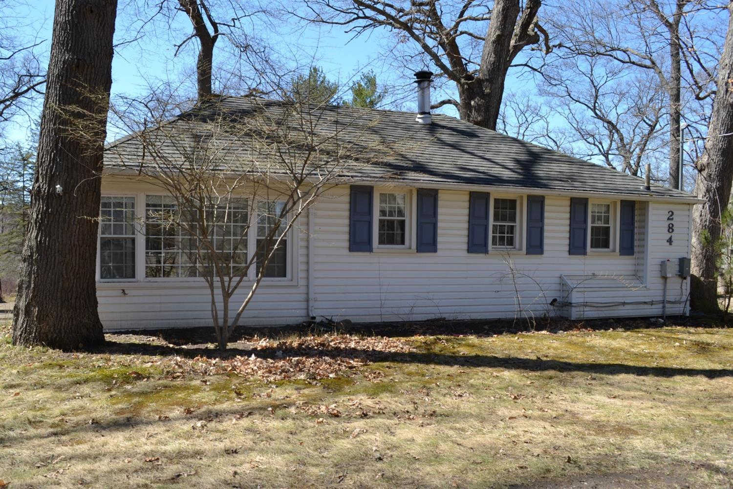 284 Ellsworth Lake Drive, Gregory, MI 48137 now has a new price of $121,900!