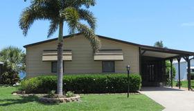 604 Puffin Drive, Barefoot Bay, FL 32976