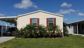 1032 Barefoot Circle, Barefoot Bay, FL 32976