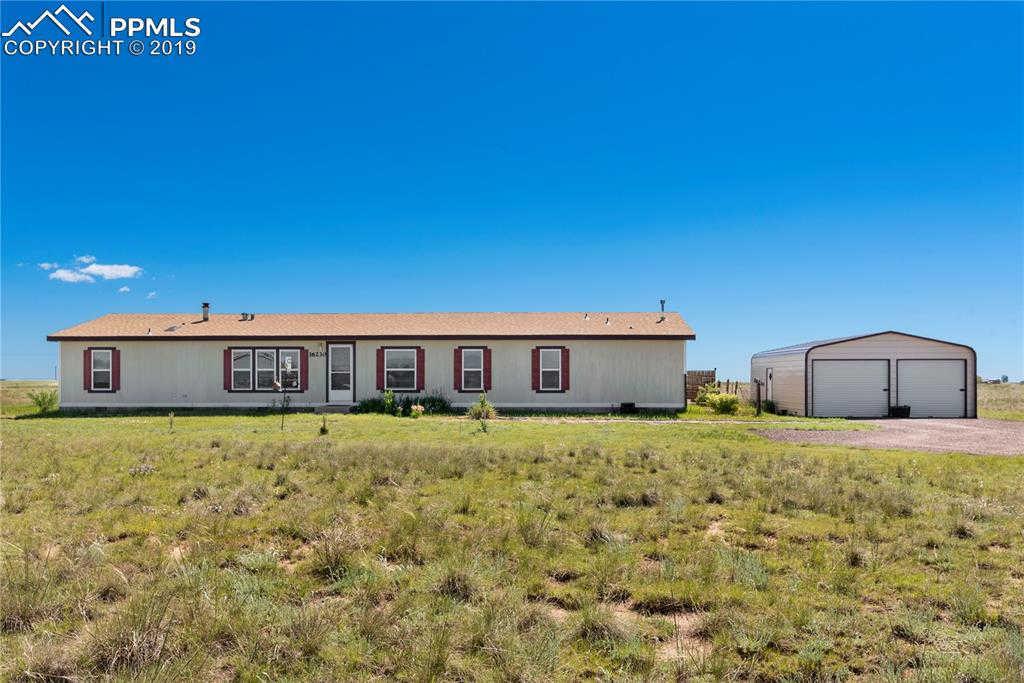 16230 Connies Drive, Peyton, CO 80831 now has a new price of $299,900!