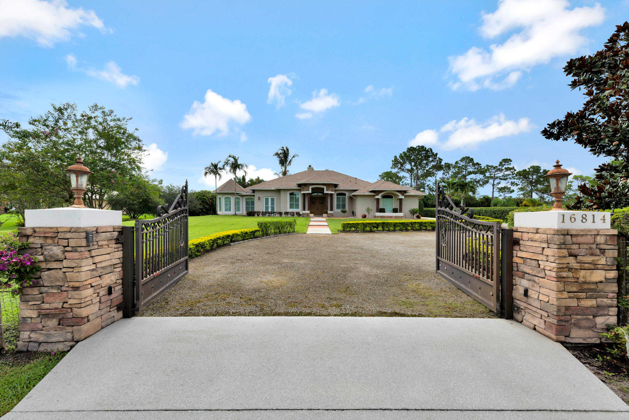 16814 Mellen Lane, Jupiter, FL 33478 now has a new price of $824,800!