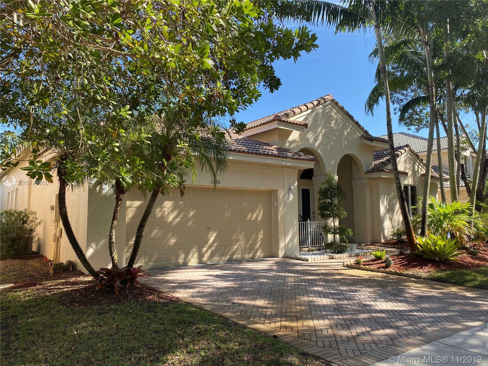 1266 Peregrine Way, Weston, FL 33327 now has a new price of $680,000!