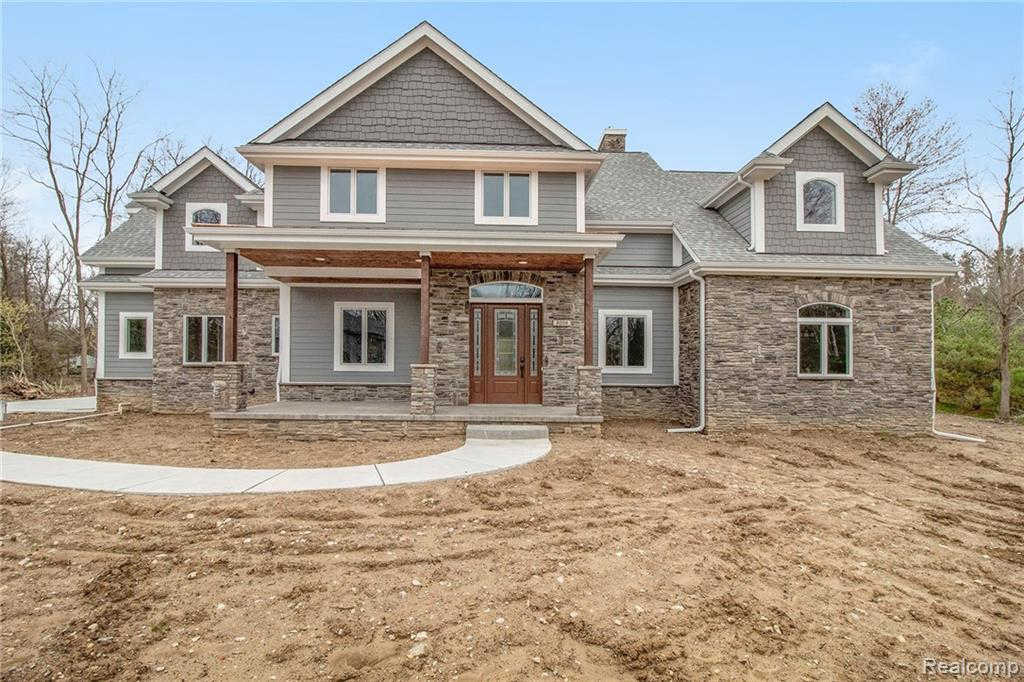 8056 Windstone CRT, Clarkston, MI 48346 now has a new price of $620,000!
