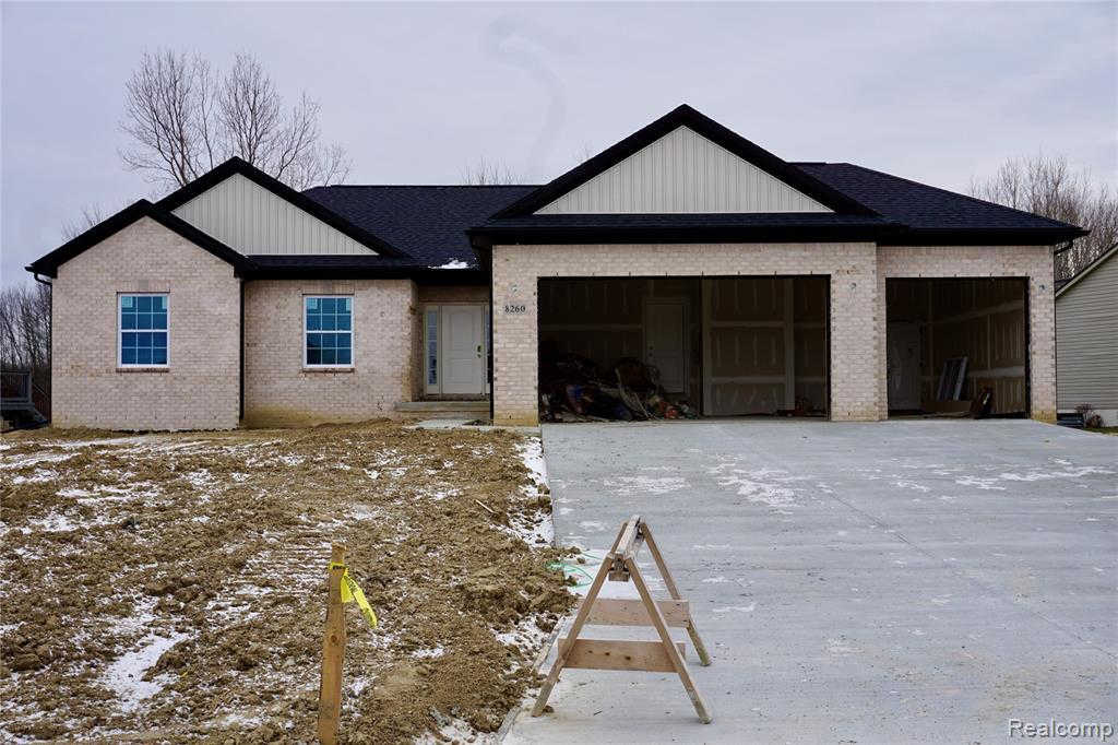8260 Peninsula Cir, Grand Blanc, MI 48439 now has a new price of $306,400!