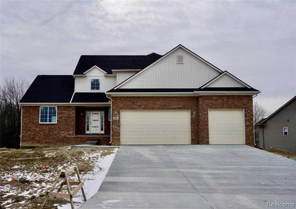 8272 Peninsula Cir, Grand Blanc, MI 48439 now has a new price of $322,400!